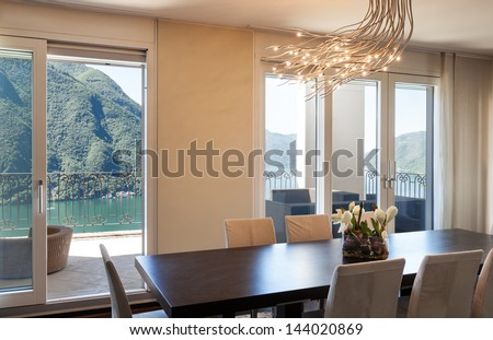 interior luxury apartment, beautiful dining room - stock photo