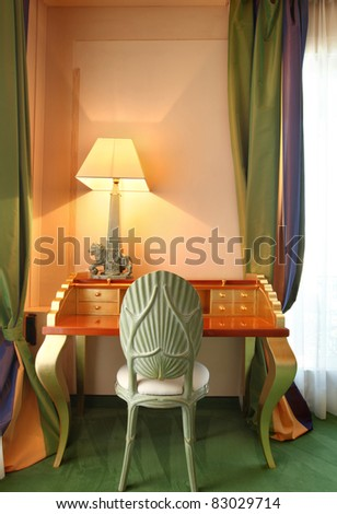 interior luxury apartment, comfortable suit, table and lamp