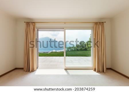 Interior, luxury villa, empty room with window  - stock photo