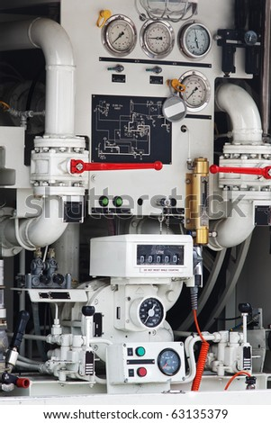 Interior mechanism of fire fighting truck with gauges and pipes - stock photo