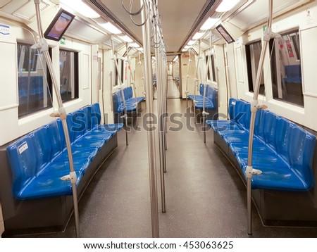 Interior metro of Bangkok, Thailand. underground subway train. Nobody in the scene. Blue seat. - stock photo
