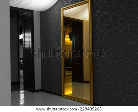 Interior mirror with reflection, selective color showing a lighted entrance door on a greyscale background - stock photo
