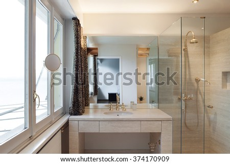 Interior, modern bathroom of an house, shower and sink - stock photo