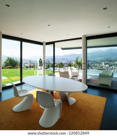 Interior modern house, dining room with big windows - stock photo