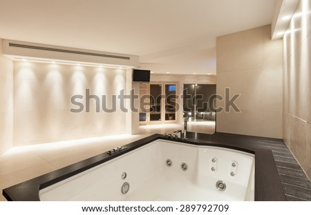 interior modern house,  wide marble bathroom with jacuzzi - stock photo