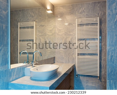 Interior modern loft, blue bathroom - stock photo
