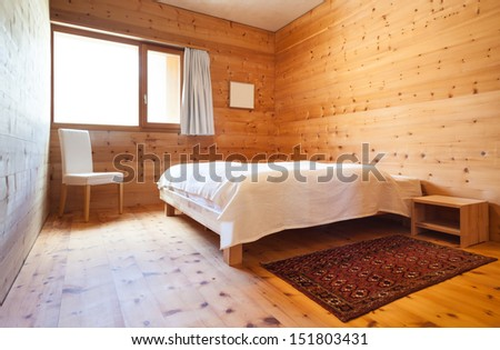interior new chalet, view of the bedroom  - stock photo