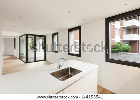 interior new house, modern white kitchen, view room with windows - stock photo