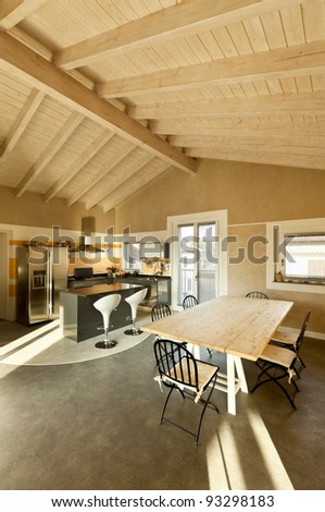 interior, new loft furnished, view of dining table and kitchen - stock photo