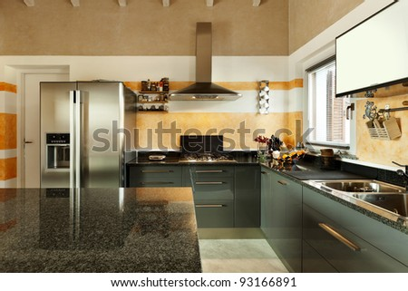 interior, new loft furnished, view of kitchen - stock photo
