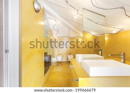 interior new loft, yellow bathroom, two sinks - stock photo