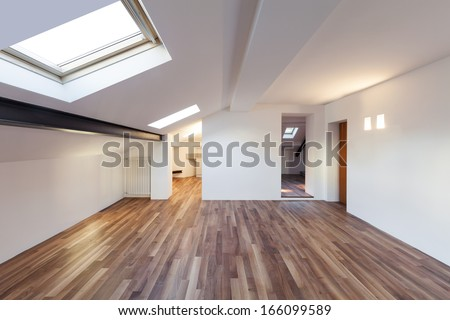 Interior nice loft, wall white, parquet floor - stock photo
