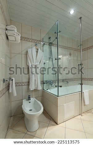 Interior of a bathroom is combined with toilet, nobody - stock photo
