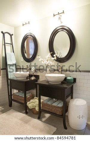 Interior of a bathroom with sinks and mirrors - stock photo