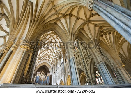 Interior of a beautiful gothic Wells Cathedral with pointed arches - stock photo
