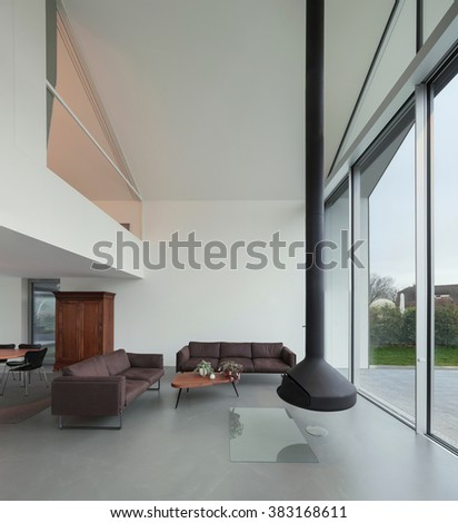 Interior of a beautiful modern house, living room - stock photo