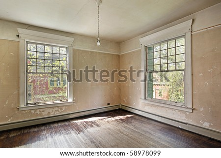 Interior of a bedroom in an old abandoned home - stock photo