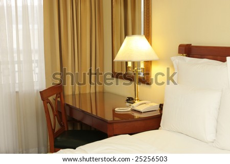 Interior of a bedroom in the hotel - stock photo