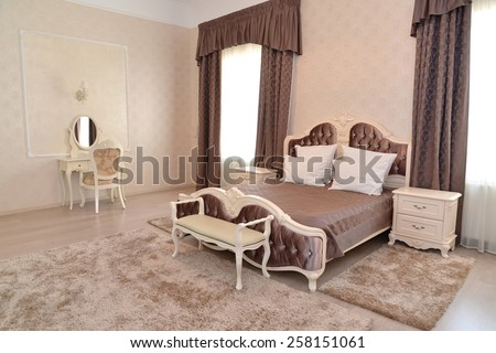 """Interior of a bedroom of a double hotel room """"luxury"""" in light tones - stock photo"""