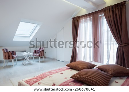 Interior of a bright white cozy bedroom in luxury loft apartment  - stock photo