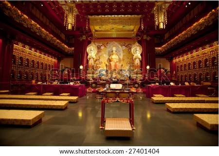 Interior of a Buddhist temple with many statues - stock photo
