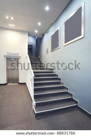 Interior of a building hall, hotel stairs, modern design in grey colors. - stock photo