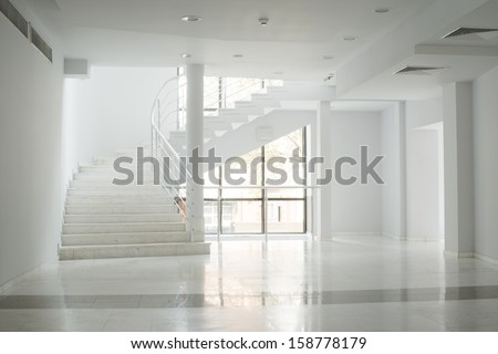 Interior of a building with white color walls. Flight of stairs
