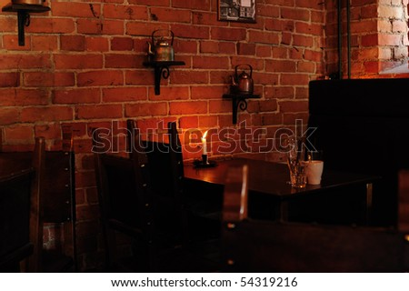Interior of a cafe with a candle on the table