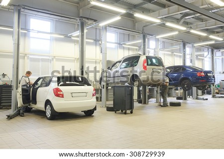 Interior of a car repair station - stock photo