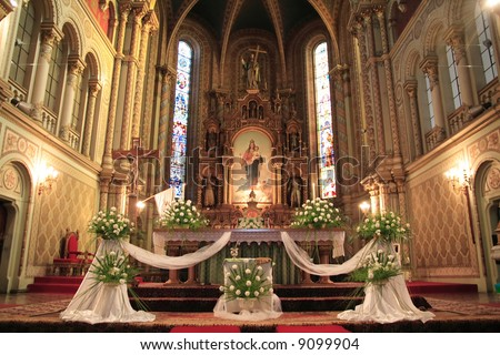 Interior of a catholic church, beautifully decorated for a wedding ceremony - stock photo