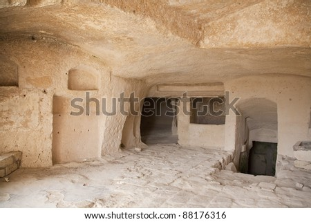 Interior of a cavern in ancient town of Matera - Sassi . It is one of the first human settlements in Italy. The Sassi are houses dug into the calcareous rock itself. Basilicata - Italy.