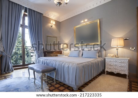 Interior of a classic style bedroom in luxury villa - stock photo