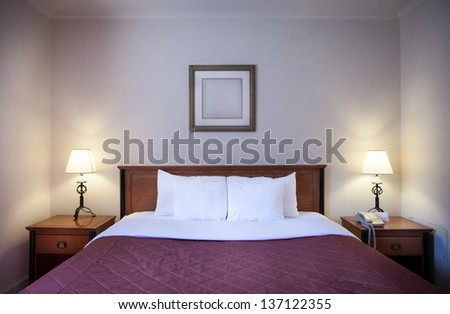 Interior of a comfortable hotel room at night - stock photo