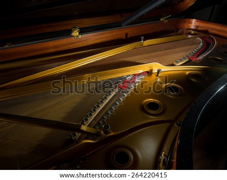 interior of a concert grand piano - shallow depth of field - stock photo
