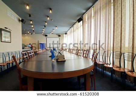 Interior of a conference hall with the big table for meetings - stock photo
