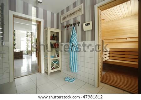 interior of a corner of bathroom with wooden sauna - stock photo