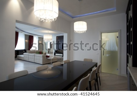 interior of a dining room with a view to a living room