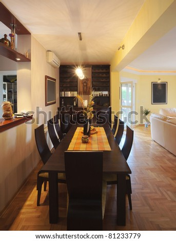 Interior of a dinning room with wooden furniture. - stock photo