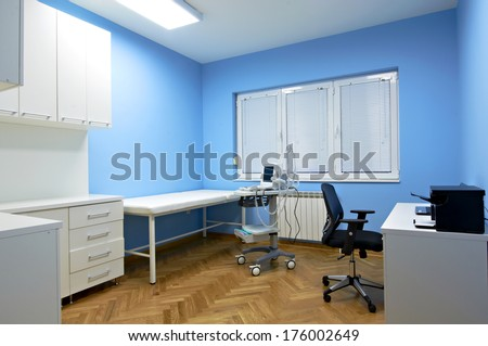 Interior of a doctor's consulting room with Medical ultrasound diagnostic equipment - stock photo