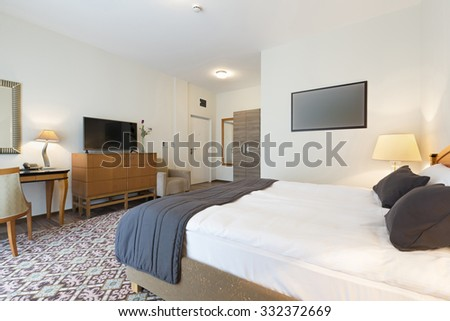 Interior of a double bed hotel room  - stock photo