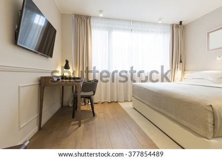 Interior of a double hotel bedroom in the morning - stock photo