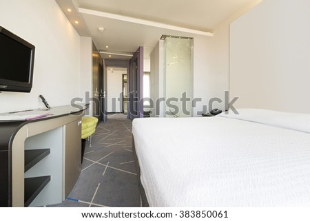 Interior of a double hotel bedroom in the morning
