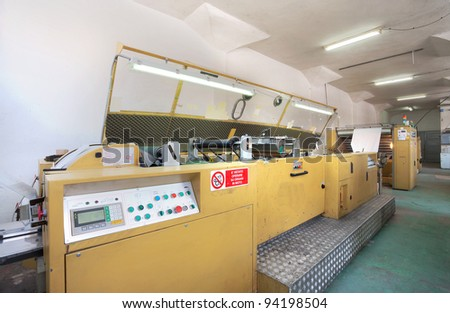 Interior of a factory, old machine for printing. - stock photo