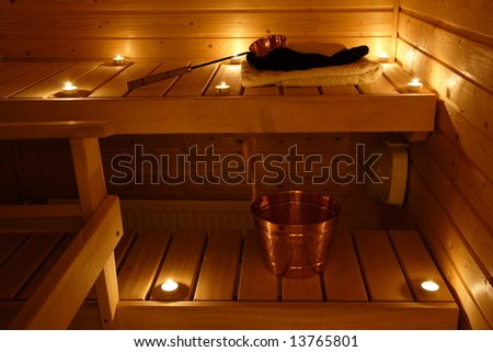 Interior of a Finnish sauna in candle light - stock photo