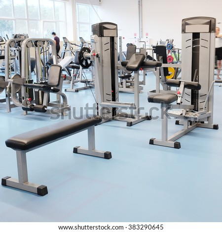 Interior of a fitness hall with fitness equipment - stock photo