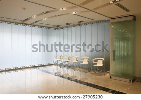 interior of a futuristic white boardroom - stock photo