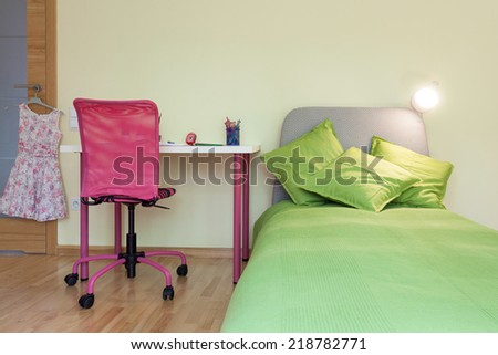 Interior of a girl's room with yellow wall - stock photo