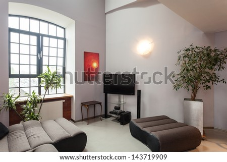 Interior of a grey living room with red painting - stock photo
