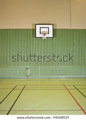 Interior of a gym with a basketball field