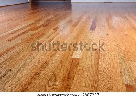 Interior of a home with refinished hardwood floors. - stock photo